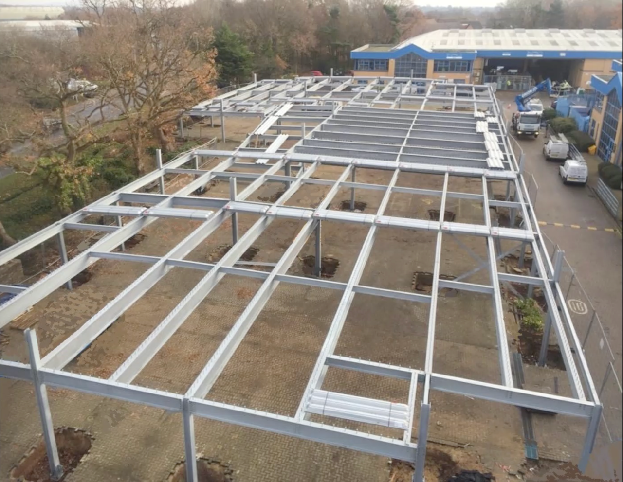 a photo of a steel frame construction for a new car park