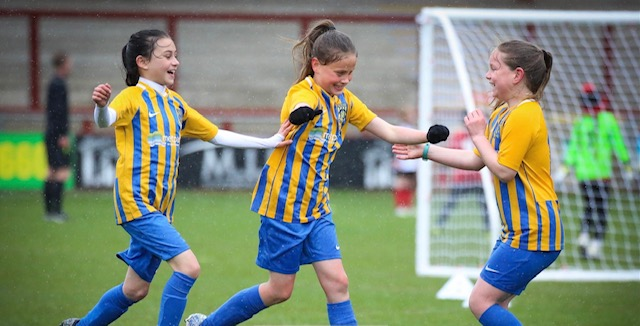 Euxton Under 9 Girls Football team celebrate a goal