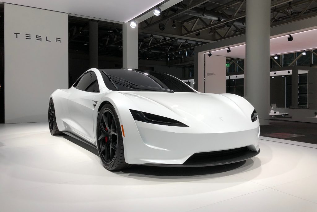 Photo of a white Tesla Roadster, an electric vehicle